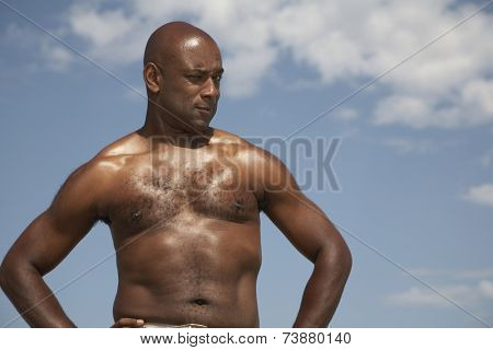 Portrait of African man with hands on hips