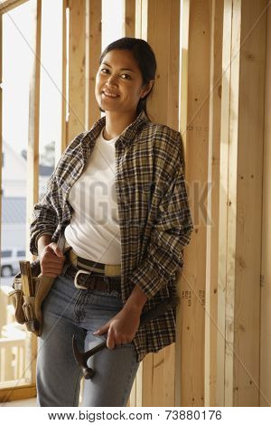 Asian female construction worker inside construction site