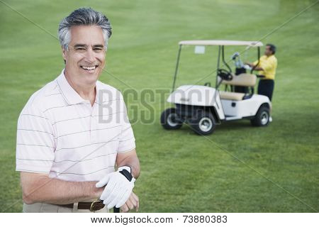 Man in front of golf cart