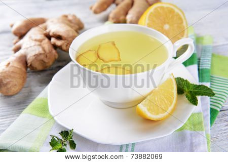Ginger tea with lemon on table close-up