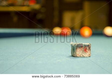 Billiard chalk on table