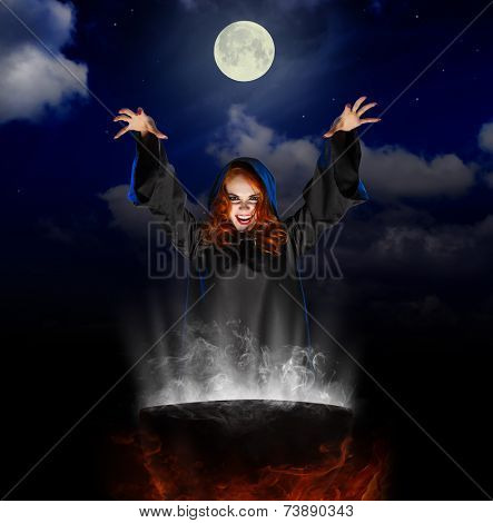 Young witch with cauldron on night sky background