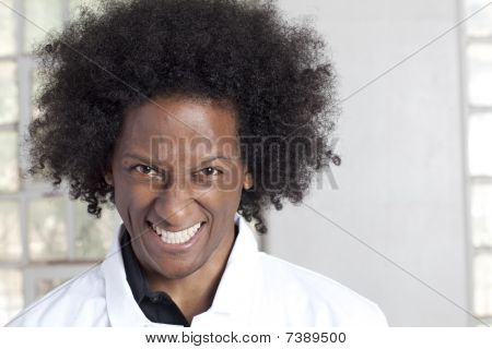 Man With Lab Coat And Afro Making A Crazy Expression