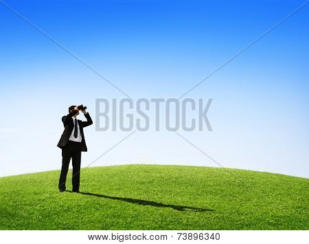 Businessman Observing Nature with a Telescope Outdoors.