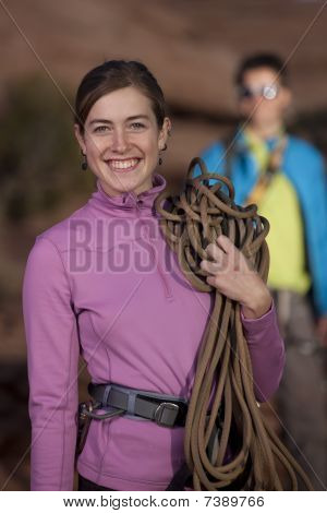 Attractive Female Rock Climber Smiling