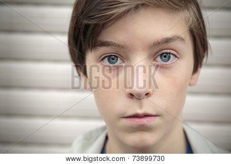 Cropped Closeup Portrait Of A Teenage Boy