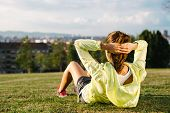 picture of crunch  - Sporty woman doing crunches workout in city park outdoor - JPG