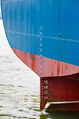 stock photo of rudder  - Stern of large ship with draft scale and rudder - JPG