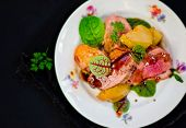 foto of duck breast  - duck breast with pears and a green salad - JPG