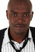 stock photo of semi-formal  - Young black African businessman in semi - JPG