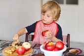picture of pie-in-face  - Happy little kid boy helping and baking apple pie in home - JPG