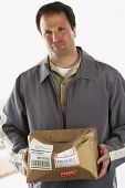 picture of fragile  - Man holding crushed package marked Fragile - JPG