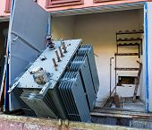 picture of transformer  - Old and broken transformer in a factory - JPG