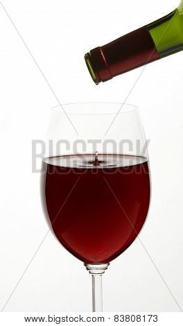 Red Wine On White Background With Droplet