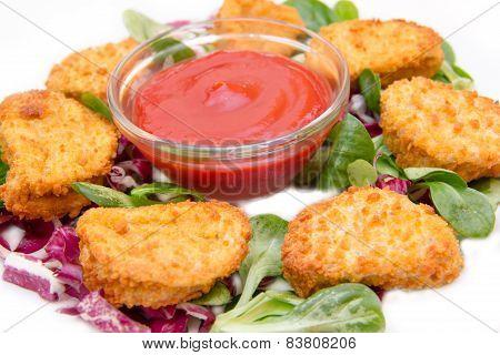 Nuggets chicken on salad close