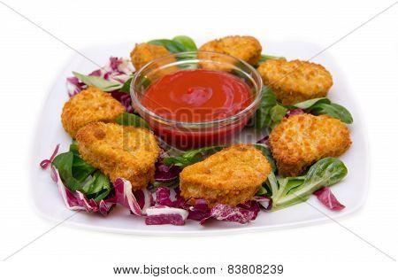 Nuggets chicken on salad