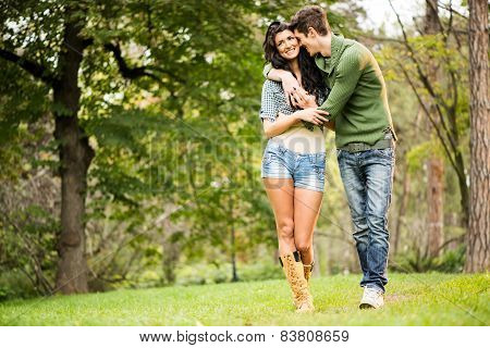 Young Couple Walking In The Park