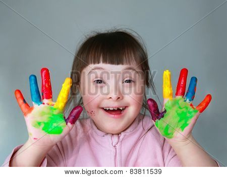 Cute Little Girl With Painted Hands. Isolated On Grey Background.