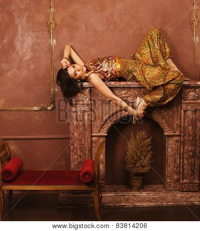 beauty sensual young woman in oriental style  luxury room