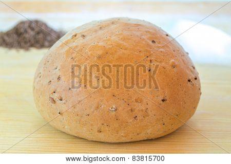 Single bun on the wooden table
