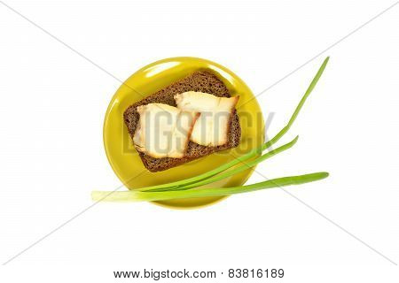 Green Plate With A Piece Of Bread And Bacon