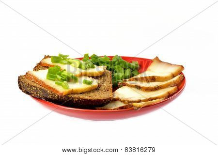 Red Plate With A Piece Of Bread And Bacon