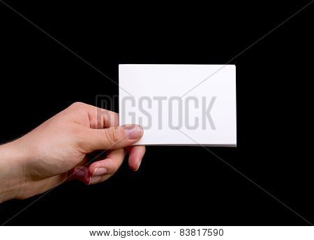 Female Hand Holding White Blank Card On Black Background