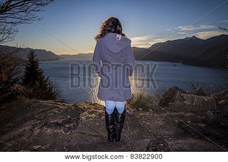Woman Looks At A Lake