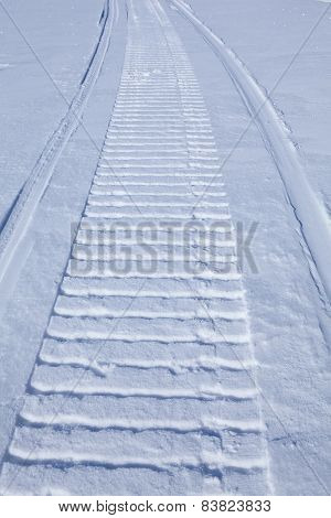 Smooth Snow With Snowmobile Trail