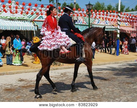 Spanish couple on a horse, Seville.