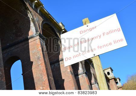 Danger falling masonry sign