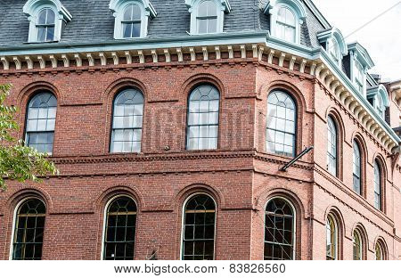 Classic Old Red Brick Building With Arched Windows