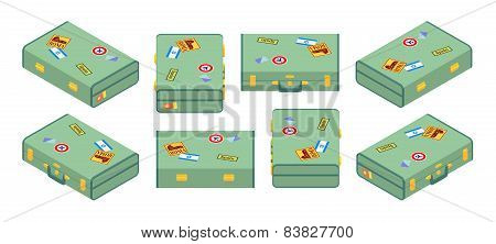 Set of lying green travelers suitcases