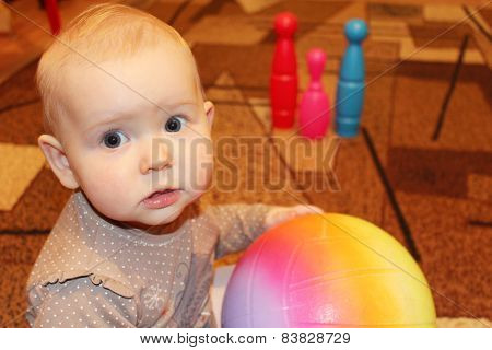 Little Baby With A Ball In Perplexity