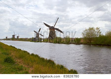 Traditional dutch windmill near the canal. Netherlands