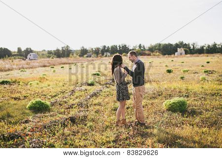 Young Couple Hugging At Sunset