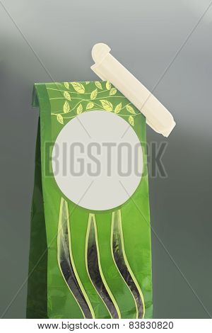 Green Bag With Tea And A Clamp