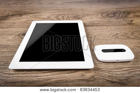 Mobile router with tablet pc. 3G or LTE network concept.