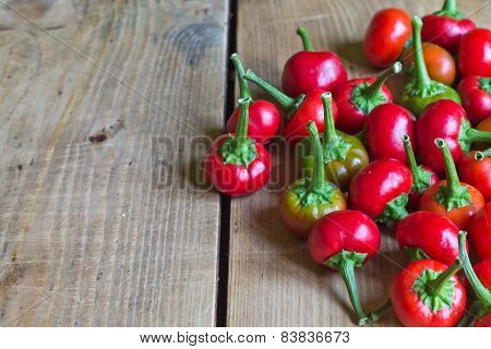 Small Spicy Red Chillies On Old Wood Table