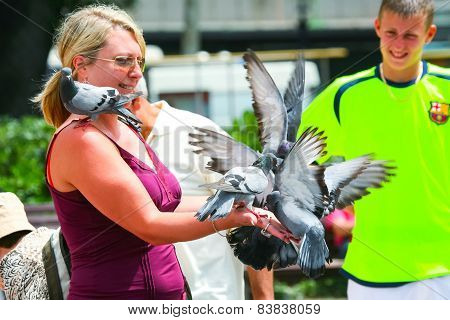 Woman With Pigeons
