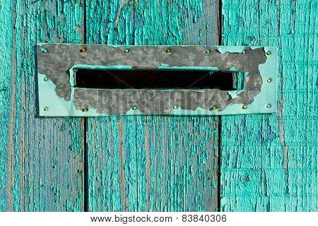 Letter Box On Blue Wood.