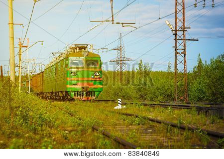Electric Freight Train Approaching Polyarnye Zori, Russia