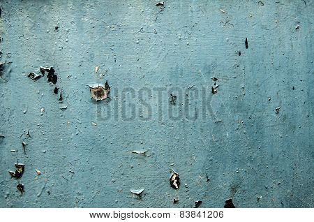 Painted blue weathered tin surface