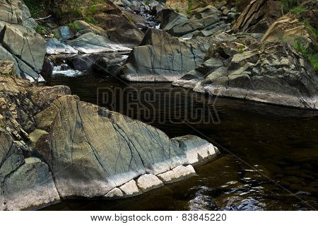 Detail of rocks in water at Black river gorge