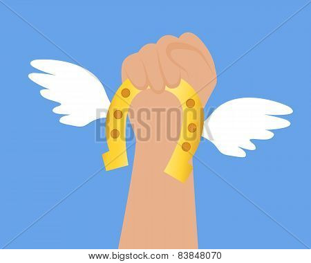 Get lucky. Hand holds a horseshoe with wings. Vector illustration