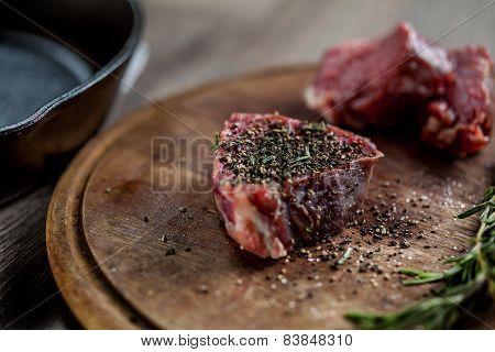Seasoned tenderloin steak lying on the board