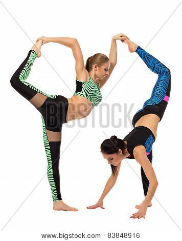 Acrobatic composition of two flexible girls