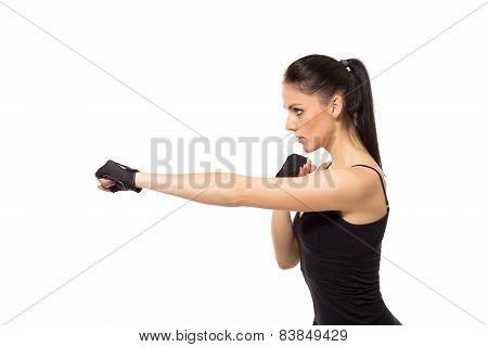 Pretty fitness girl training kick boxing