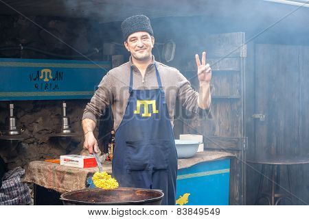 Lviv, Ukraine - February 22, 2015 Crimean Tatar Runs Street Food Business