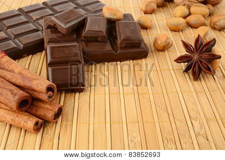 Romantic Set Of Chocolate,anise And Cinnamon On Wooden Mat